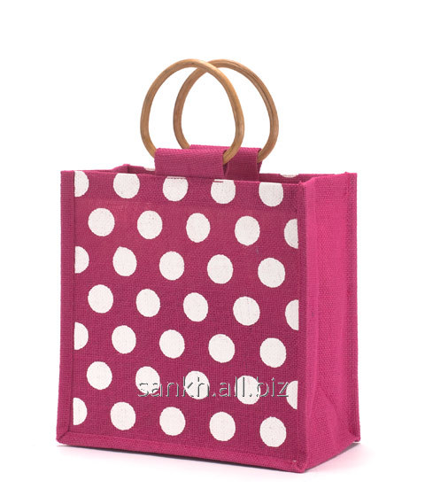 Polka dot print jute bag with cane handle