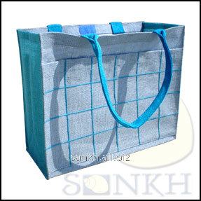Turquoise color jute bag with front pocket and cotton webbed handle
