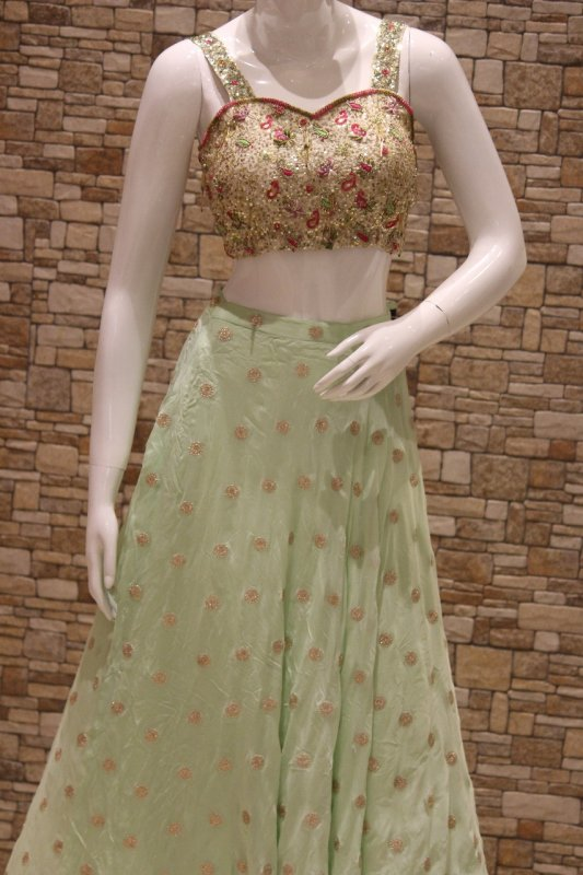 Buy Ivory hand embroidered bralet with a mint green flared skirt.