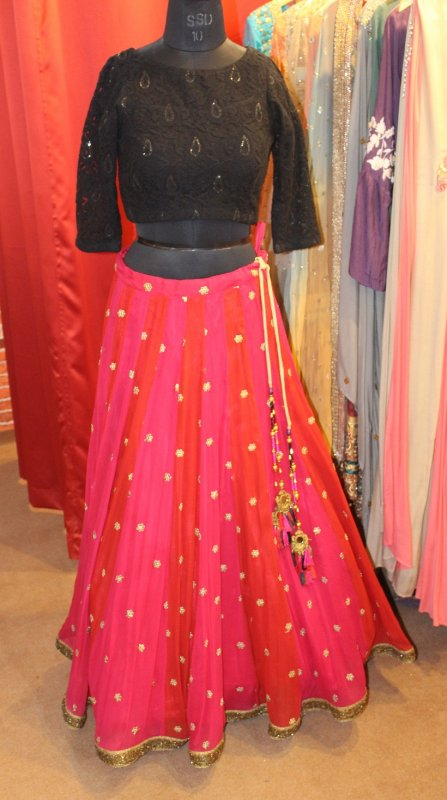 Buy Black net blouse with red with hot pink zari flower skirt