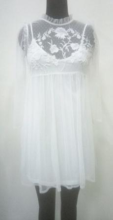 White color women dress with net emboroidered