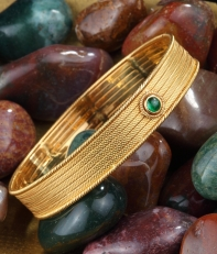 Handcrafted textured bezelset gold bangle with a