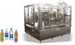 Bottle filling, capping, labeling machines