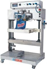 Semi-automatic, vacuum packaging machine