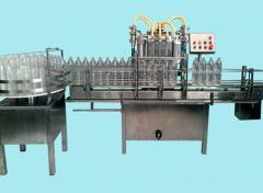 AUTOMATIC 4 HEAD BOTTLE FILLING MACHINES