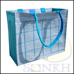 Turquoise color jute bag with front pocket and
