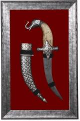 Framed Decorative dagger on red background without glass