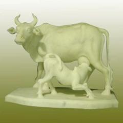 Cow and calf handicraft sculpture