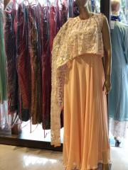 Peach colour gown with one sided draped cape