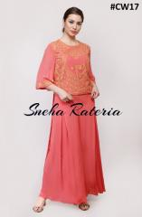 Peach georgette top with ankle length back and yellow aari work on it  pairing it with inverted box pleat pant