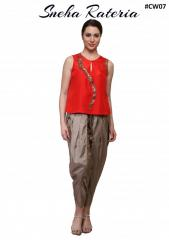Red short top with mukesh work pairing it with grayish brown dhoti pants