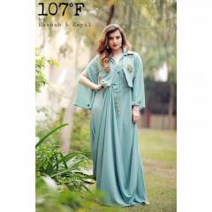 Drape dress with affixed jacket and embellishment
