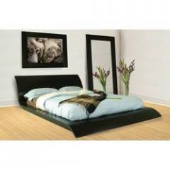 Carved wooden beds