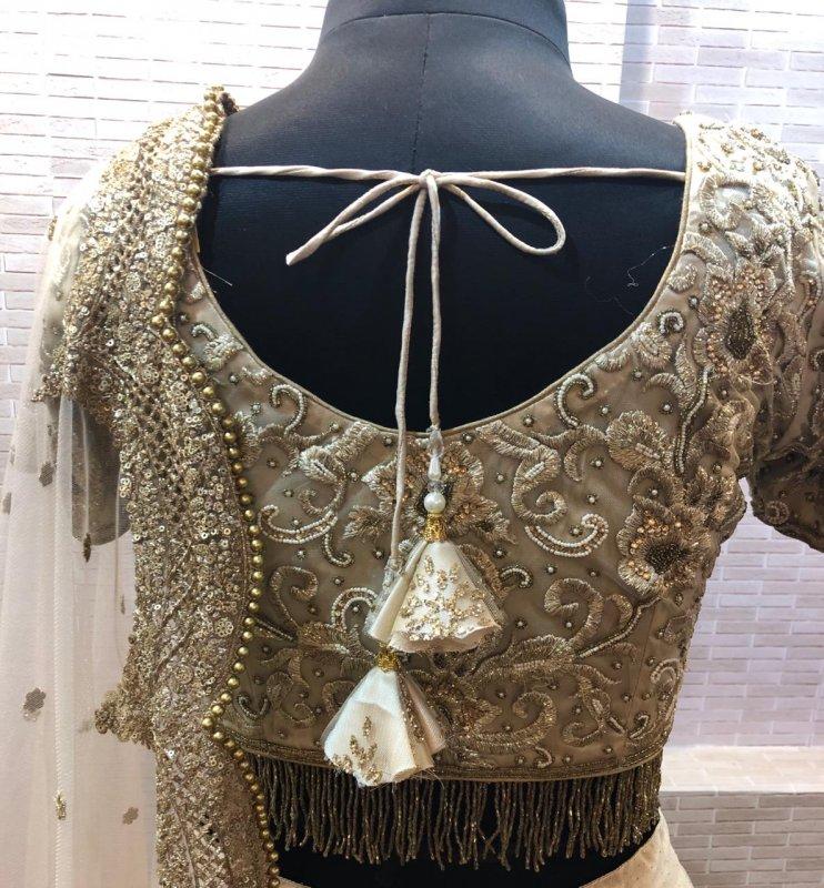 light_ivory_glitter_net_with_zari_work_dress